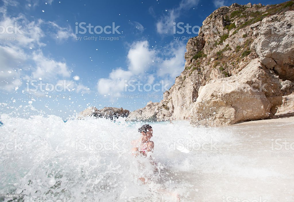 Young woman on the beach stock photo