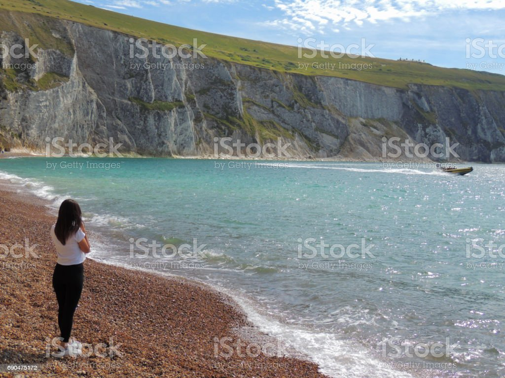 Young Woman on the Beach, Watching Lifeboat stock photo