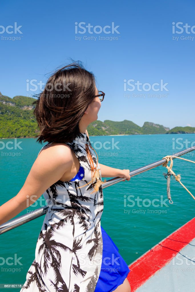 Young woman on the boat stock photo
