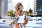istock Young woman on the go in the city 1290483921