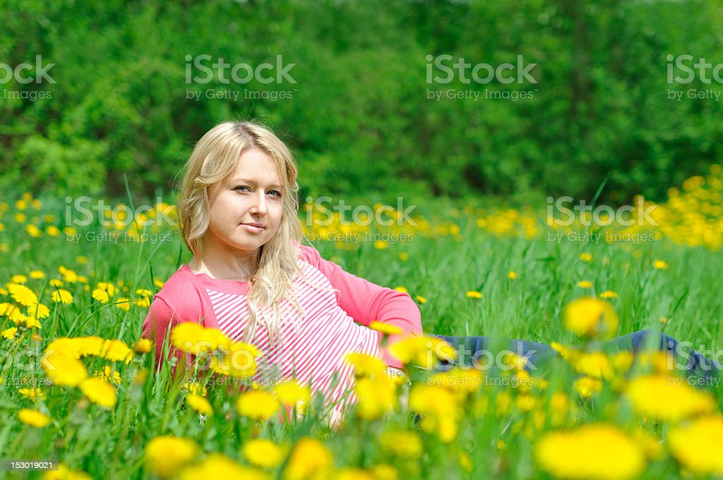 young woman on the grass royalty-free stock photo