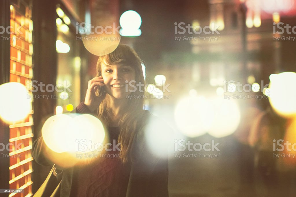 Young woman on the phone, in camera double exposure stock photo