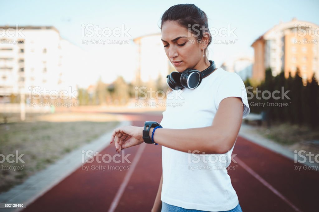 Young woman on the running track in the morning stock photo