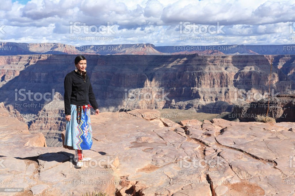 Young woman on top of the Grand Canyon royalty-free stock photo
