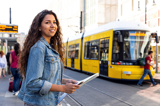 Young woman on travel in Berlin - Germany during summer holidays
