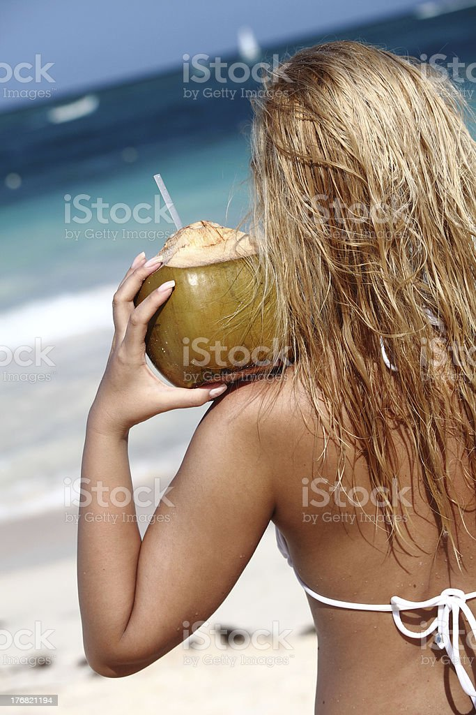 Young woman  on tropical beach royalty-free stock photo