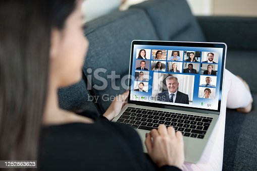 Young Woman on Video Conference on laptop computer at home