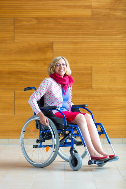 young woman on wheelchair in the medical center stock photo