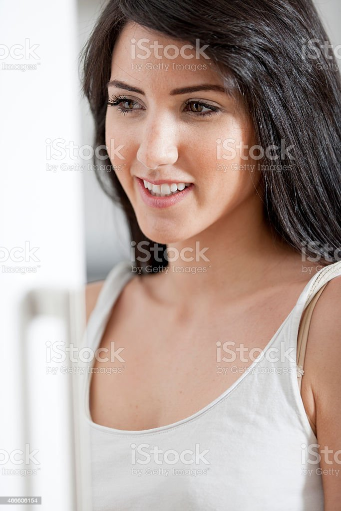 Young woman opening cupboard stock photo