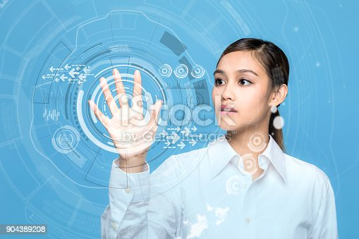 istock Young woman operating futuristic user interface. 904389208