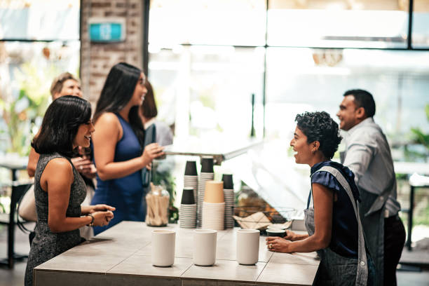Young woman ordering coffee while her colleagues are queuing picture id945653028?b=1&k=6&m=945653028&s=612x612&w=0&h=sbm13ki gpdsgaaw 6hptvm rcmjjfakypf1kw31bpe=