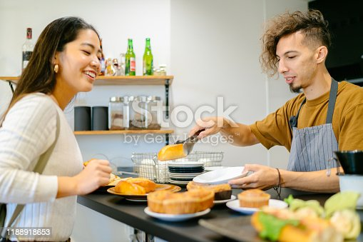 597640822 istock photo Young woman ordering food and drink at cafe 1188918653