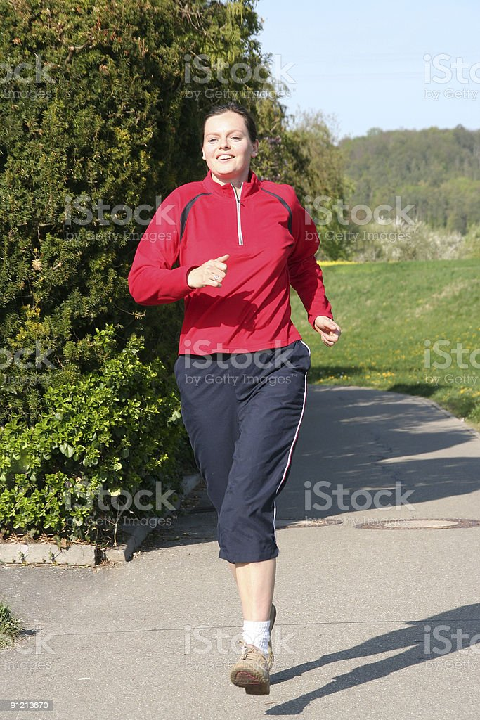 young woman out for jogging in the afternoon royalty-free stock photo