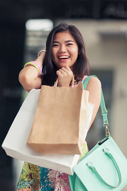 young woman out shopping - philippines girl stock photos and pictures