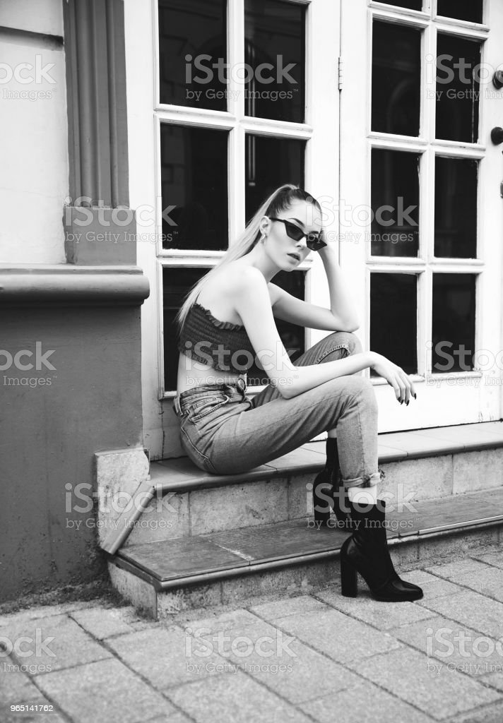 Young woman outdoor black and white portrait zbiór zdjęć royalty-free