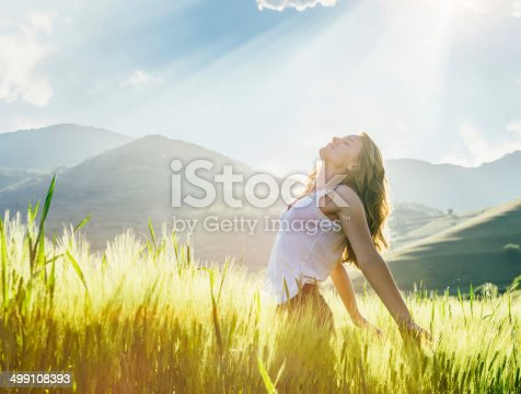 istock Young woman outdoor enjoying the sunlight 499108393
