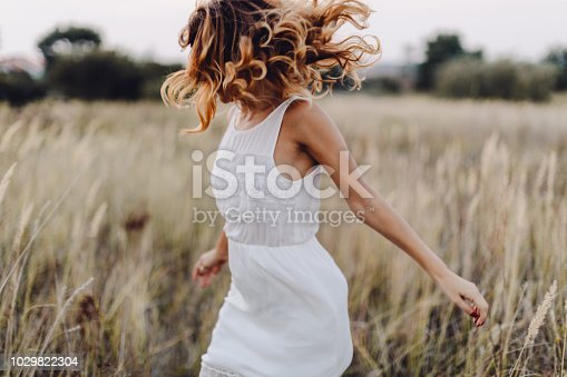 istock Young woman outdoor enjoying the sunset 1029822304