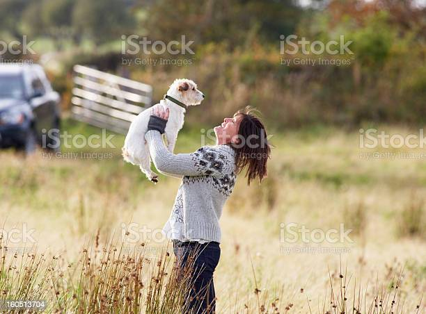 Young woman outdoors in autumn landscape holding dog picture id160513704?b=1&k=6&m=160513704&s=612x612&h=3dfqnllmzinqpnymabzitfsbhe uur06zyspep1xlhw=