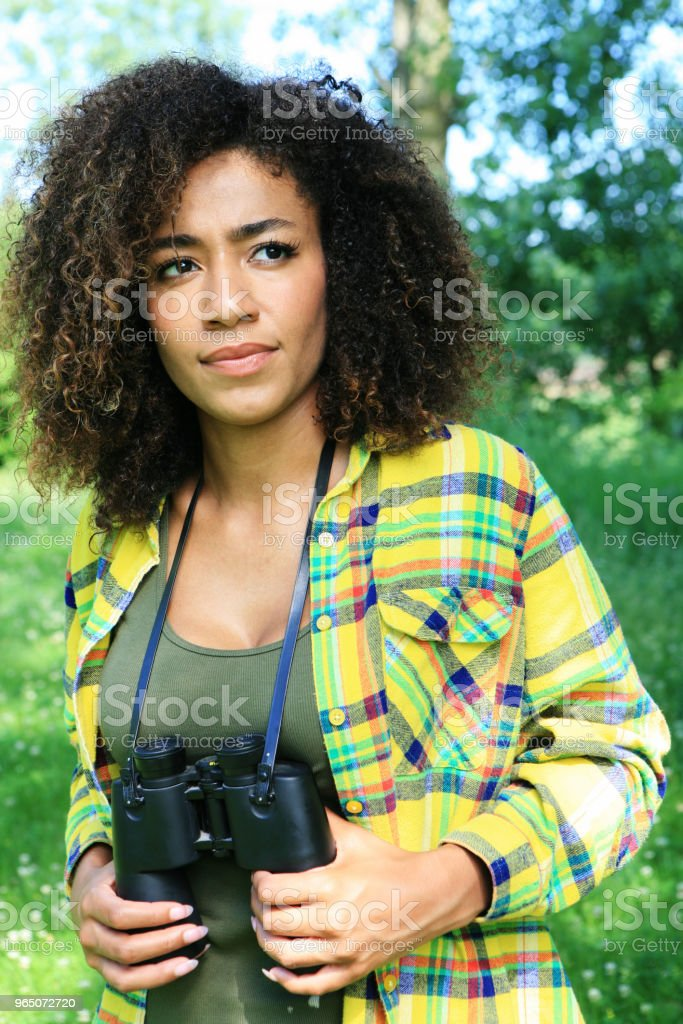 Young woman outdoors in nature zbiór zdjęć royalty-free