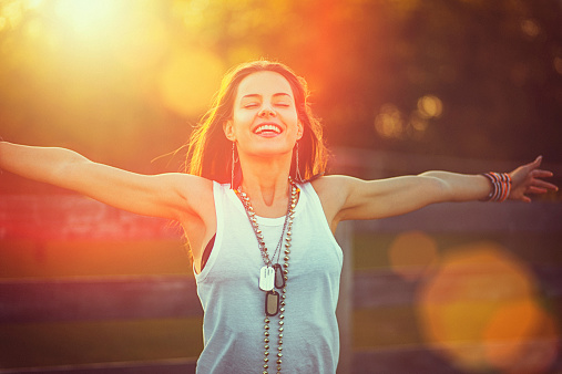 Young Woman Outstretched Arms Enjoys The Freedom And Fresh Air Stock Photo - Download Image Now