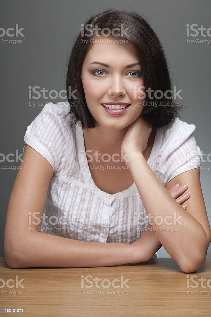 Young Woman Over Gray Background royalty-free stock photo