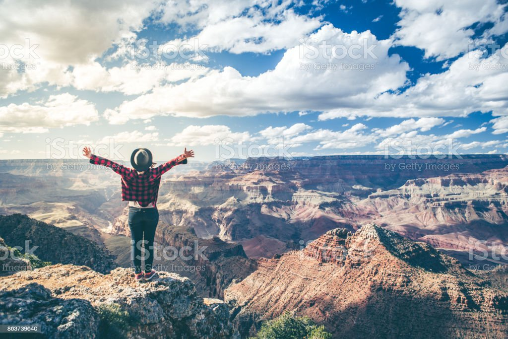 Young Woman Overlooking The Grand Canyon stock photo