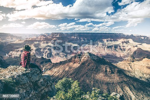 istock Young Woman Overlooking The Grand Canyon 863739652