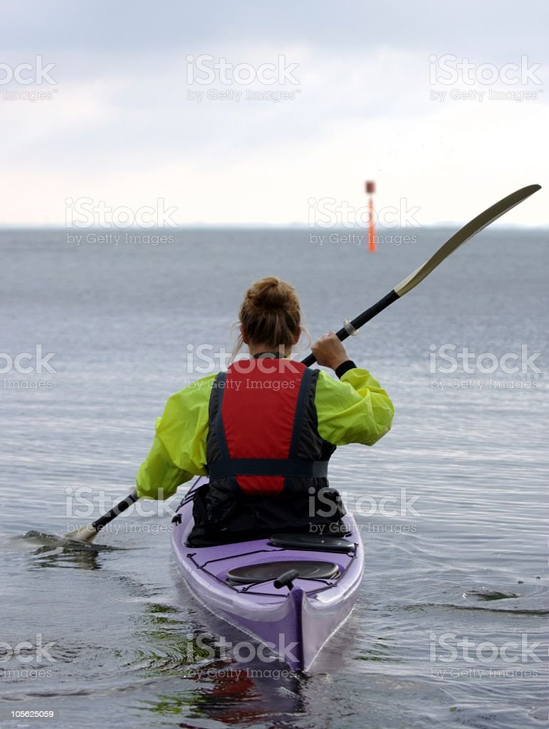Young woman paddling in a kayak royalty-free stock photo