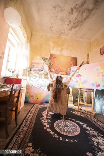 Young Woman Painter in her Studio