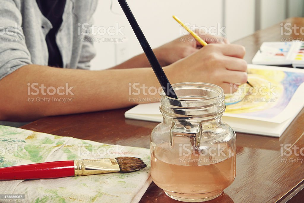 Young Woman Painting A Small Watercolor royalty-free stock photo