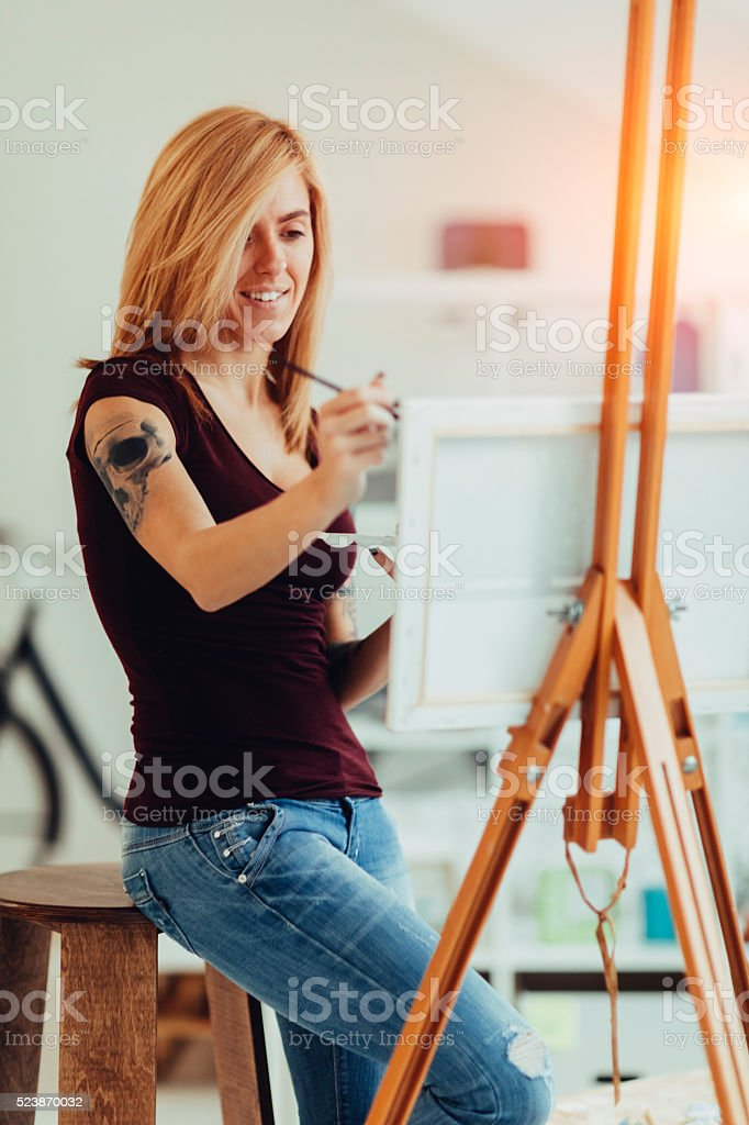 Young Woman Painting At Home. stock photo