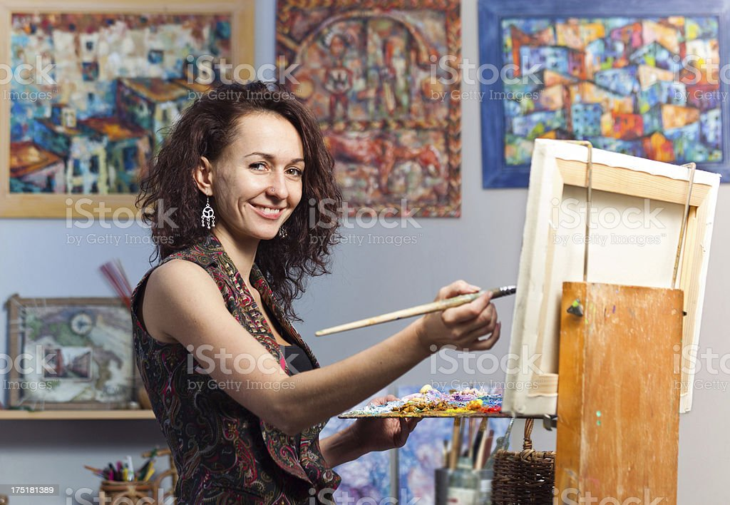 Young woman painting in her studio stock photo