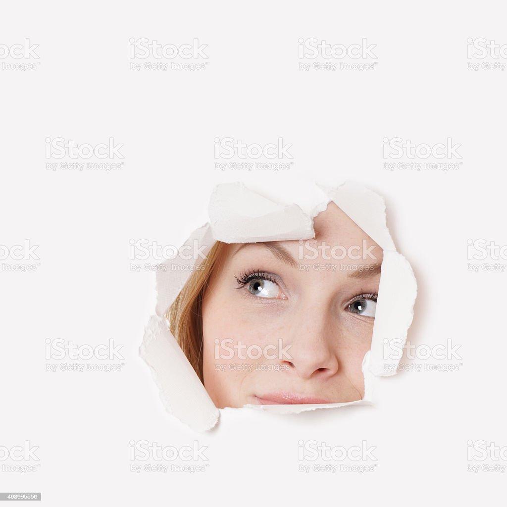 young woman peeking stock photo