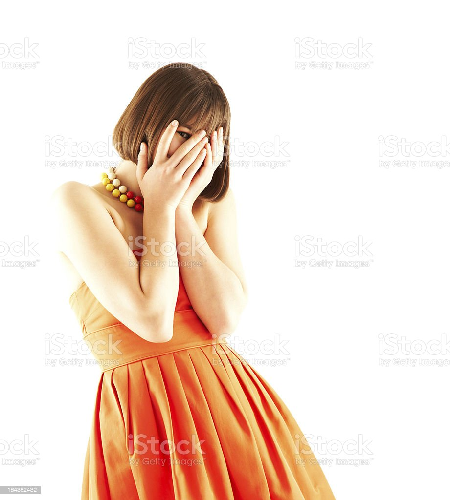 Young woman peeking through covered face stock photo