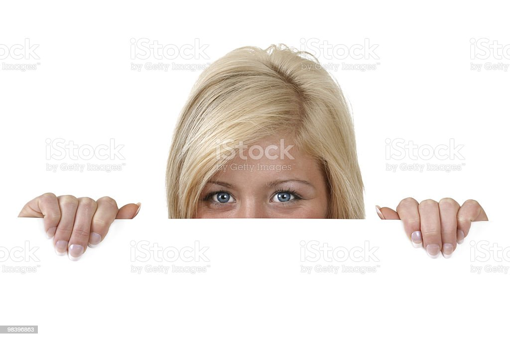 Young woman peering over edge of blank sign royalty-free stock photo