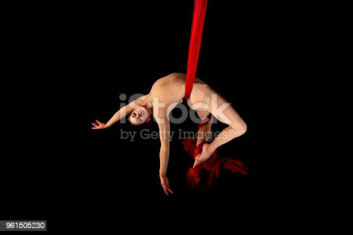 Angela is a student of the first performing arts course in Granada. Acrobatic silks session in photography studio