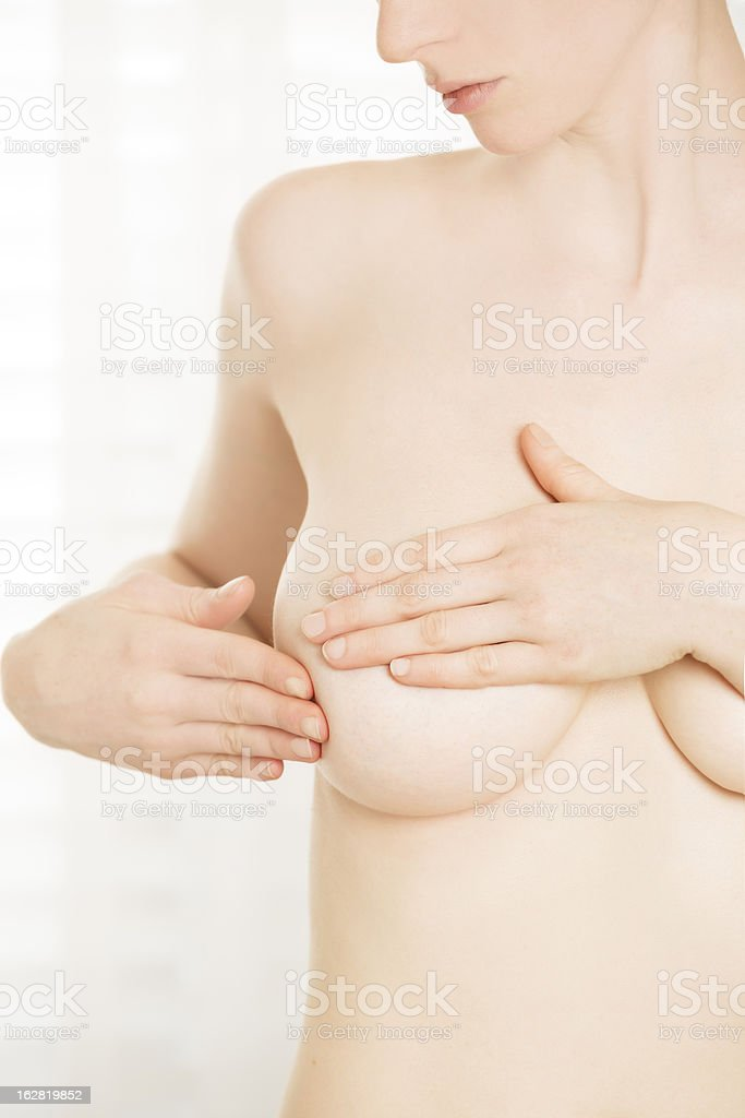 Young woman performing breast cancer self-exam royalty-free stock photo