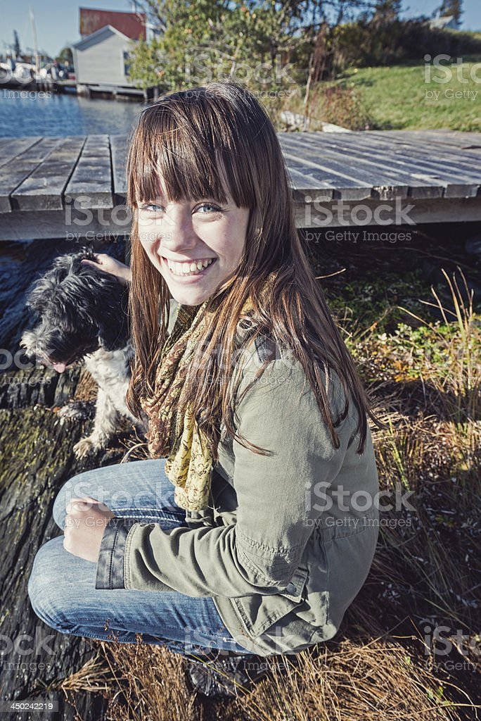 Young woman petting her dog royalty-free stock photo