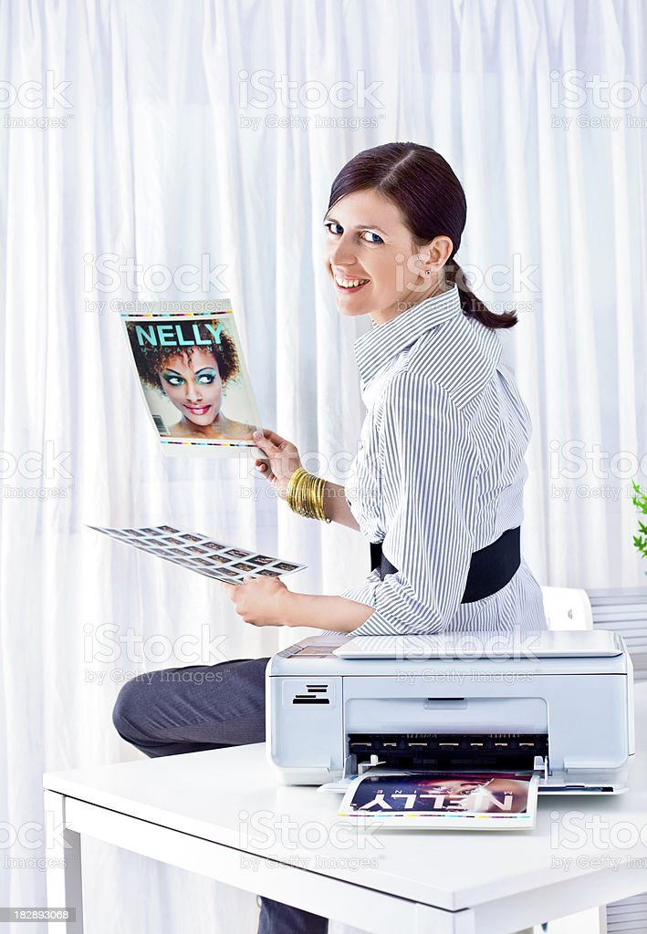 Young woman photo editor at work royalty-free stock photo