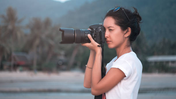 Young woman photographer taking pictures of landscape at sunset picture id940779802?b=1&k=6&m=940779802&s=612x612&w=0&h=wdt80h2mehftsd2e27gtf87pvfjzhmdookbbxphza0g=