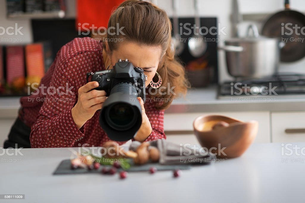young woman photographing food stock photo