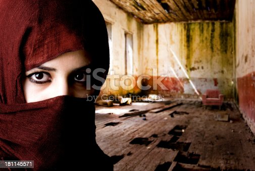 young muslim woman in ruined house (digital composite)
