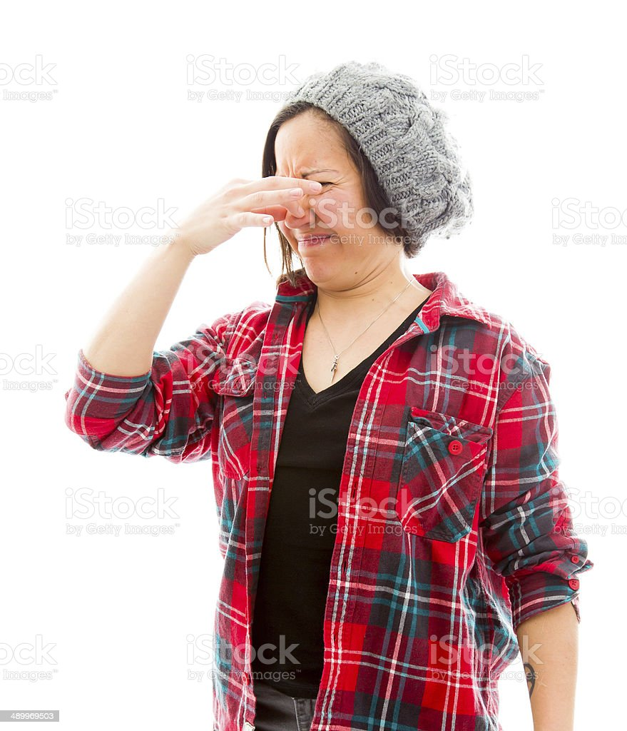 Young woman pinches her nose stock photo