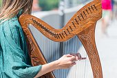 Regensburg, Germany, Mai 18, 2018, A young woman playing a harp