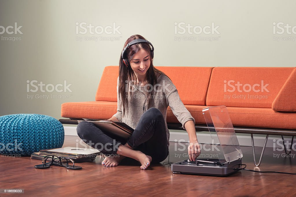 Young Woman Playing A Record stock photo
