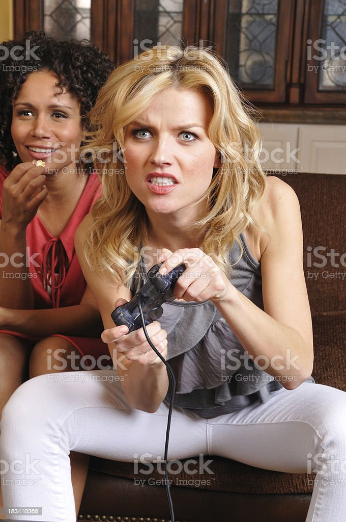 Young Woman Playing a Video Game royalty-free stock photo