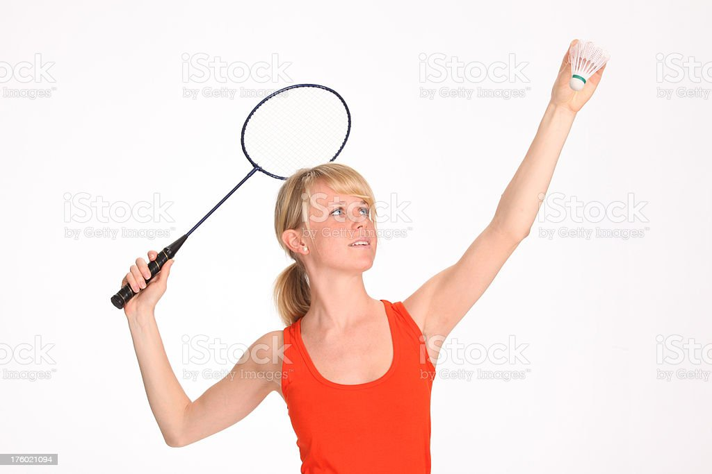 Young woman playing badminton royalty-free stock photo