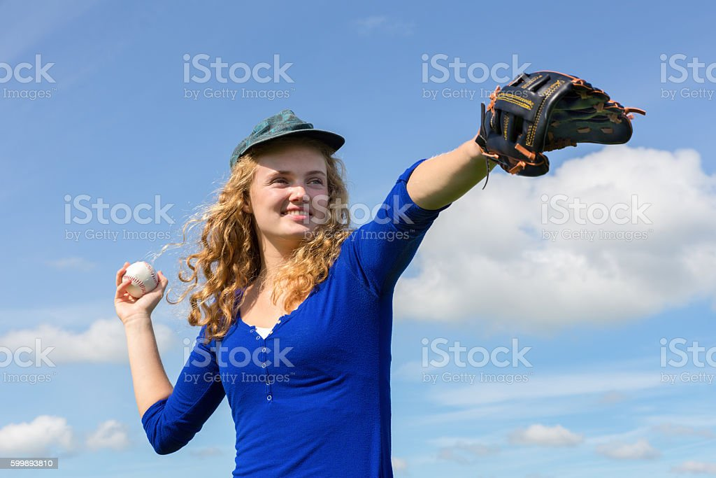 Young woman playing baseball with cap glove and ball stock photo