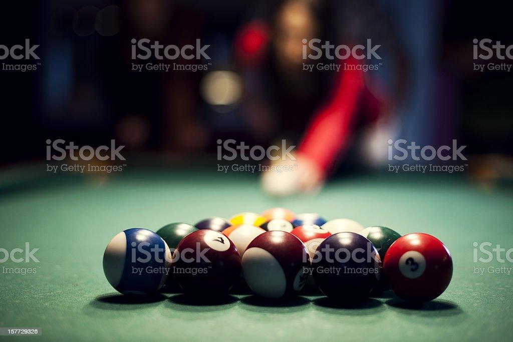 Young woman playing billiard stock photo