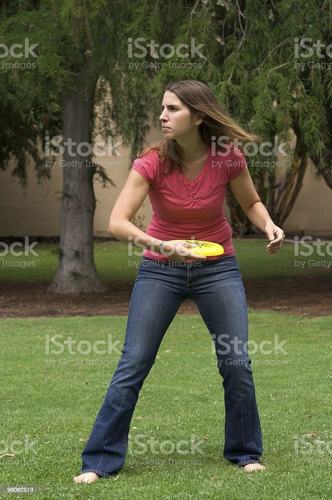 Young Woman Playing Frisbee in the Park royalty-free stock photo